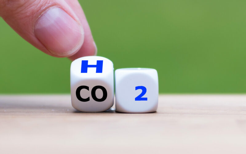 Change to fuel cell vehicles. Hand flips a dice and changes the expression CO2 to H2.